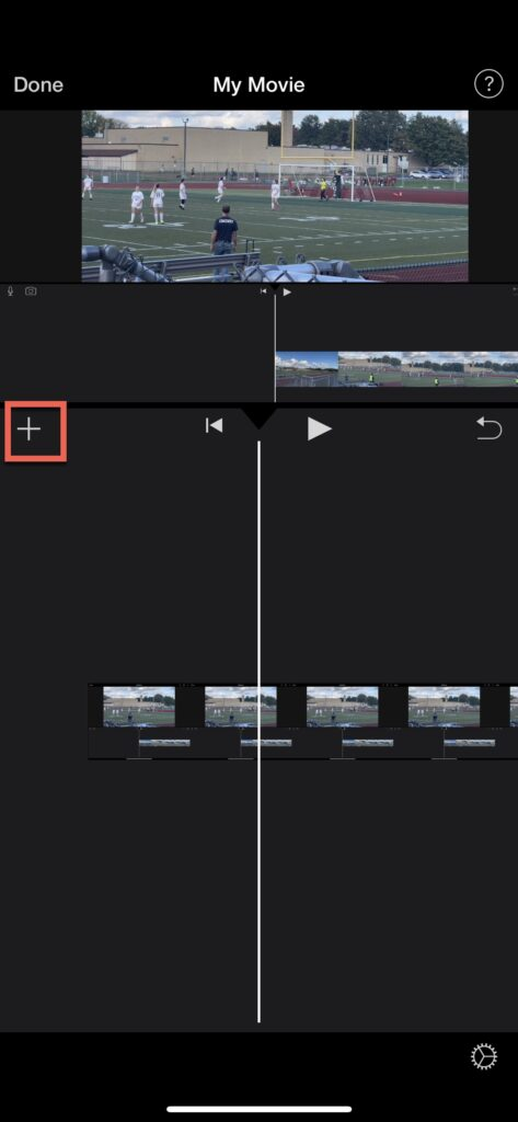 Click the + button to bring up import audio options in iMovie for iPhone