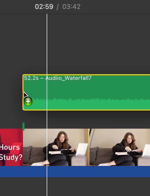 You can add an audio clip at a specific part of your iMovie project